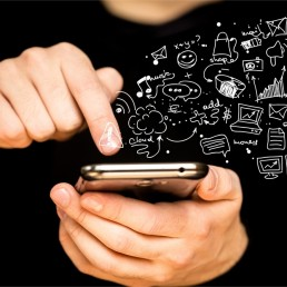 Man holding phone with mobile app icons appearing