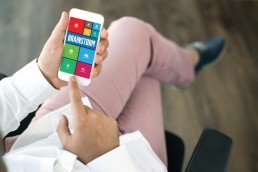 Businessman using smart phone app