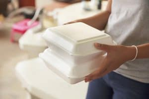 Woman carrying polystyrene takeaway boxes